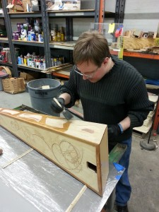 Applying finish to the harp