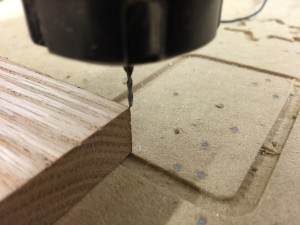 The bit at the corner of the work after the plate has been removed and the bit put back to 0