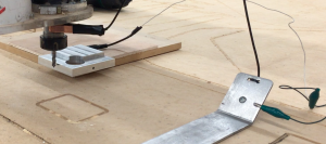 The cable connects the XYZ plate to the Z plate that comes with the Shopbot for finding the Z axis.
