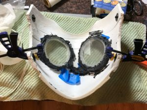 Sealing the acrylic eyes in with silicone